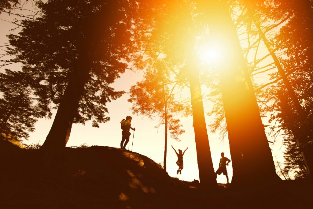 three hiker silhouettes on a sunset hike in the northern virginia trial